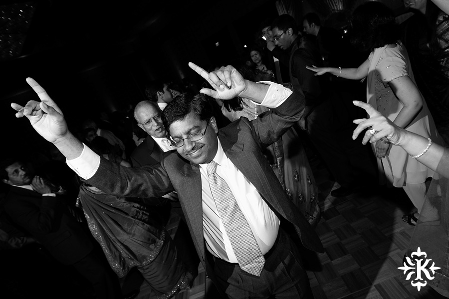 Austin wedding photographer Tony Ku photographs an Indian wedding reception in downtown Hilton Hotel, Austin, Texas. (24)