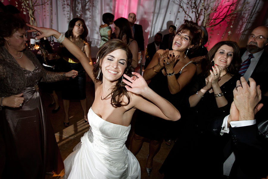 Austin wedding photographer Tony Ku photographs a bride having the time of her life at her wedding.