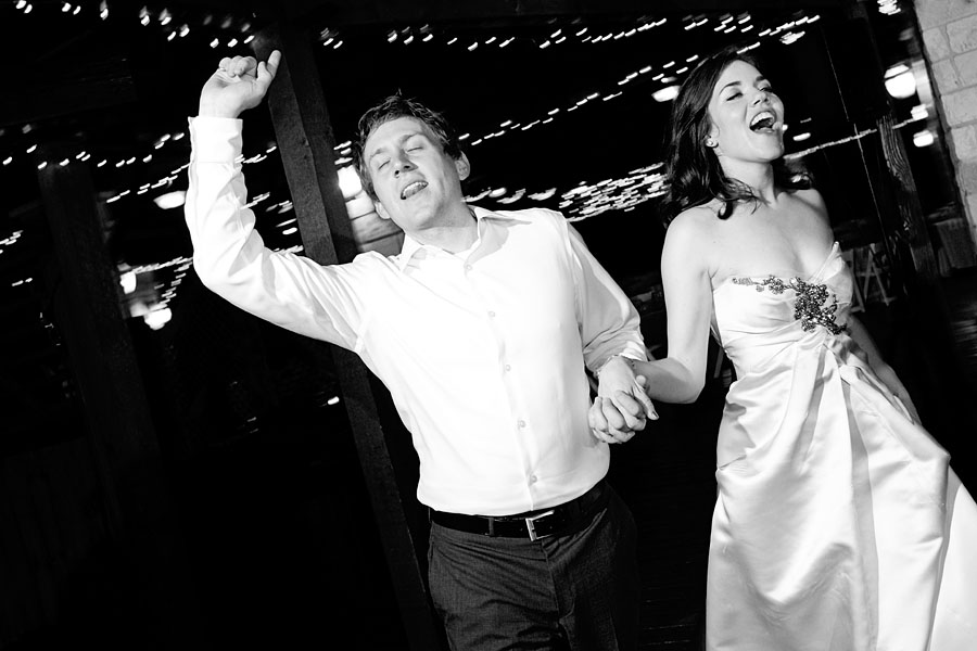 Happily married couple singing during their wedding reception in Austin, photographed by Austin wedding photographer Tony Ku