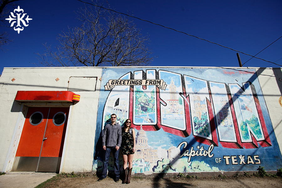 Greetings from Austin Texas Mural engagement photo, photographed by Austin wedding photographer