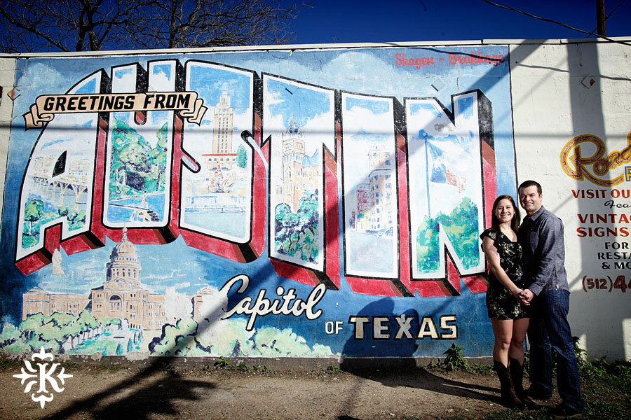 engagement photo at the greetings from austin texas mural photographed by austin wedding photographer Tony Ku
