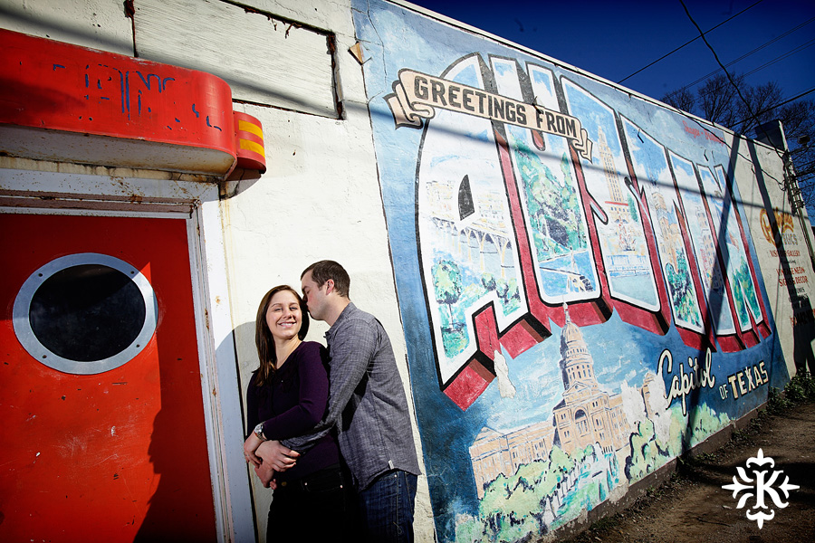 "engagement photo at the mural of ""Greetings from Austin Texas"" in south Austin, photographed by Austin wedding photographer Tony Ku"