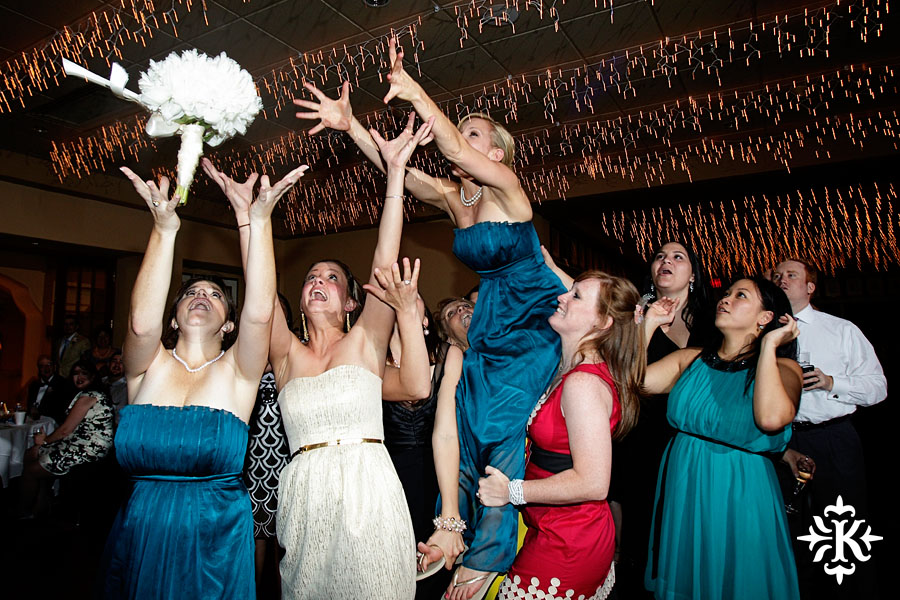 bouquet catch at the Houston Yacht club wedding photographed by an Austin wedding photographer