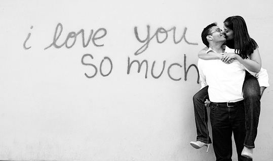 Engagement photo at the I Love You So Much Mural, by austin wedding photographer Tony Ku