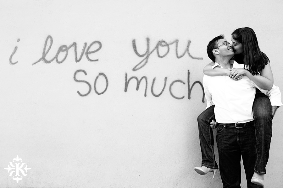 austin wedding photographer Tony Ku takes engagement photos at the I Love You So Much mural in Austin, Texas